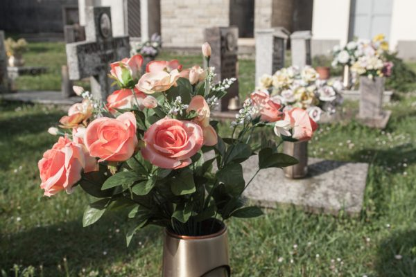 Flowers on a grave in italian cemetery
